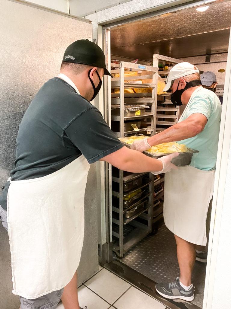 Volunteers storing prepped food
