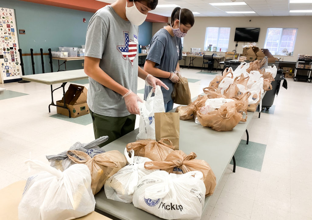 Volunteers packing to-go meals for COVID