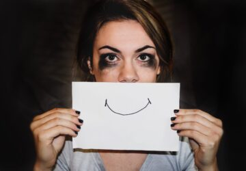 Person hides sorrow behind a smile